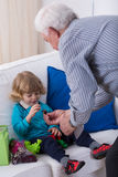 Grandparent and little grandson Stock Photography