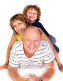 Grandparent lying on floor with grandson Royalty Free Stock Photo