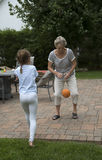 Grandparent playing with young girl Royalty Free Stock Images