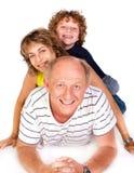 Grandparent que encontra-se no assoalho com neto foto de stock royalty free
