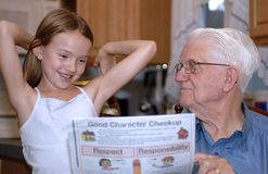 Grandparent Teaching Wisdom. This is a picture of my father giving my daughter a few words of wisdom Royalty Free Stock Image