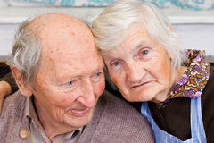 Grandparents. Old happy grandparents staying together on the bed Royalty Free Stock Images