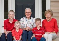 Grandparents. With Their Three Grandchildren Stock Photography