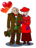 Grandparents. A loving elderly couple walks together, holding balloons in the form of hearts Stock Photo