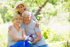 Grandparents with adult granddaughter Royalty Free Stock Photography