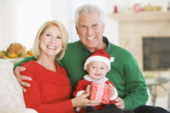Grandparents With Baby In Santa Outfit Stock Photography