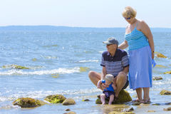 Grandparents at the beach. With their grandson Royalty Free Stock Photography