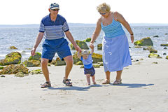 Grandparents at the beach. With their grandson Royalty Free Stock Images