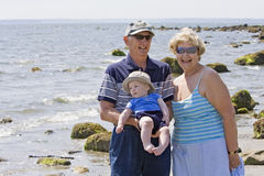Grandparents at the beach. With their grandson Stock Images