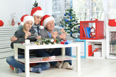 Grandparents with boy preparing for Christmas Royalty Free Stock Image