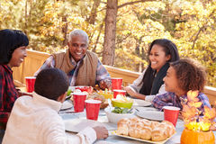 Grandparents With Children Enjoying Outdoor Meal Stock Photos