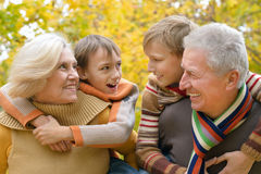 Grandparents with children in park Royalty Free Stock Image