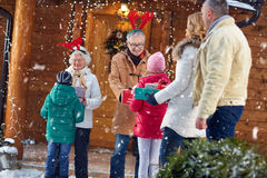 Grandparents at Christmas eve gathering family. Happy grandparents at Christmas eve gathering family Royalty Free Stock Images
