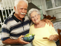 Free Grandparents Cooking At Home. Stock Images - 23352794