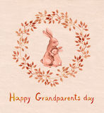 Grandparents day greeting card. Grandparent rabbit hugging kid. Watercolor Stock Images
