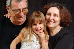Grandparents felizes com o neto que mostra a lingüeta fotografia de stock royalty free