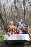 Grandparents and kids riding on four wheeler with trailer Stock Images