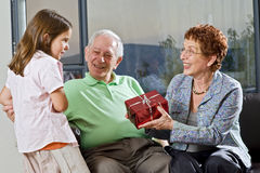Grandparents gift grandchild Stock Image