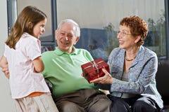 Grandparents gift grandchild Stock Image