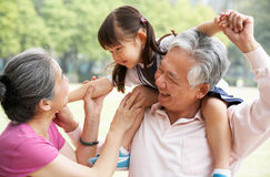 Grandparents Giving Granddaughter Ride stock photos
