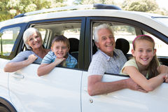 Grandparents going on road trip with grandchildren Royalty Free Stock Images