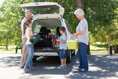 Grandparents going on road trip with grandchildren. On a sunny day stock image