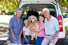 Grandparents going on road trip with grandchildren. On a sunny day royalty free stock image