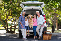 Grandparents going on road trip with grandchildren. On a sunny day stock photo