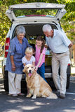 Grandparents going on road trip with grandchildren Stock Images