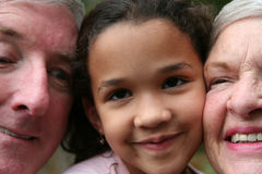 Grandparents with Grandaughter royalty free stock photography