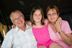 Grandparents with grandchild Stock Photography