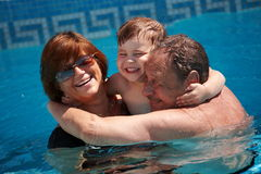 Grandparents and grandchild Stock Photos