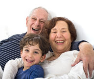 Grandparents grandchild bed Royalty Free Stock Photo