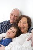 Grandparents grandchild bed Stock Images