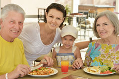 Grandparents with grandchild at breakfast Royalty Free Stock Images