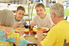 Grandparents with grandchild at breakfast Stock Image