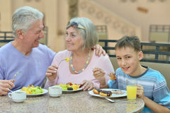 Grandparents with grandchild at breakfast Royalty Free Stock Image