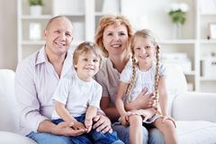 Grandparents with grandchildren. At home royalty free stock photos