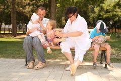 Grandparents and grandchildren stock photos