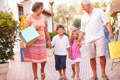 Grandparents With Grandchildren Carrying Shopping Bags Royalty Free Stock Photo