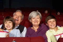 Grandparents and Grandchildren In Cinema royalty free stock images