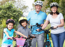 Grandparents And Grandchildren On Cycle Ride In Countryside Stock Images
