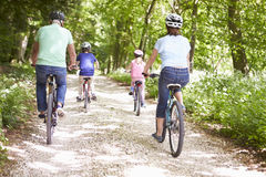Grandparents With Grandchildren Cycling In Countryside Stock Photo