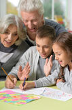 Grandparents and grandchildren drawing. Portrait of happy grandparents and grandchildren drawing together royalty free stock image
