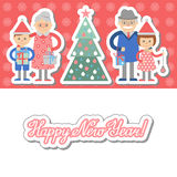 Grandparents and grandchildren with gifts in front of Christmas tree. Stock Photography