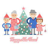 Grandparents and grandchildren with gifts in front of Christmas tree. Royalty Free Stock Image