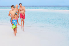 Grandparents And Grandchildren Having Fun On Beach Holiday Royalty Free Stock Photos
