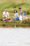 Grandparents And Grandchildren Having Picnic On Riverbank Royalty Free Stock Photography