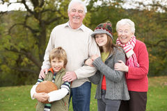 Grandparents With Grandchildren Holding Football Royalty Free Stock Photos