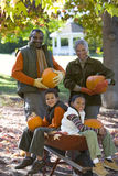 Grandparents and grandchildren holding pumpkins in autumn Stock Photography